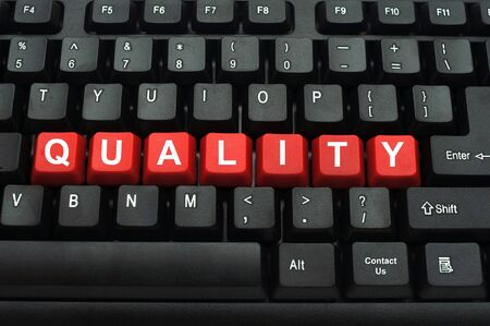 word quality on red keyboard key  photo