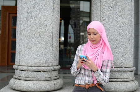 Young asian muslim woman in head scarf  photo