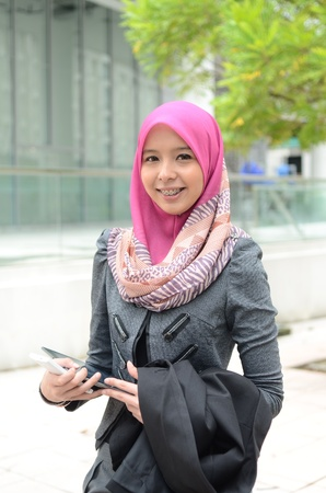 corporate culture: Close-up portrait of beautiful young Asian Muslim woman