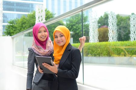 muslim girl: Young asian muslim woman in head scarf smile