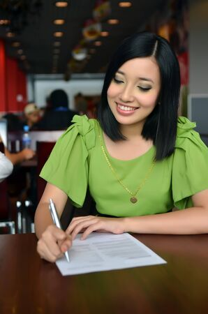 Woman filling the form on job interview  photo
