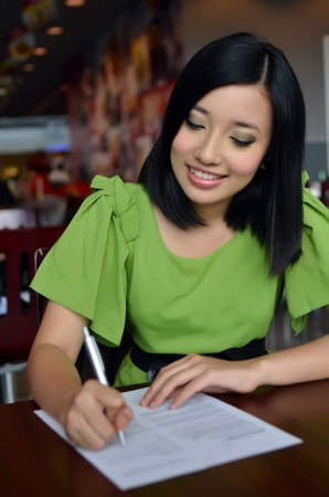 completing: Woman filling the form on job interview  Stock Photo