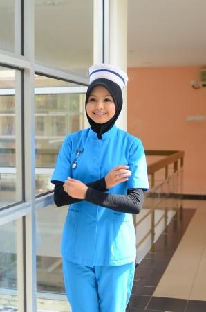 arab hijab: Confident Young asian muslim nurse at hospital
