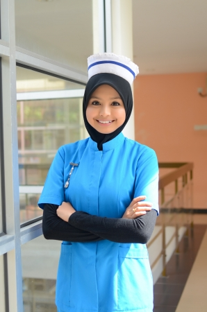 malay ethnicity: Confident Young asian muslim nurse at hospital