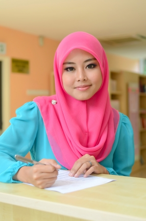 Young asian muslim woman in head scarf smile  photo