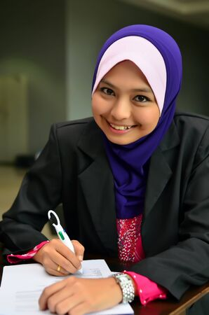 Beautiful young muslim college girl smile  photo