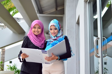 young muslim woman in head scarf study together photo