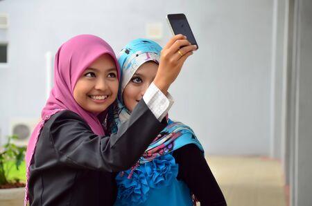 pretty young woman take photo by mobile phone photo