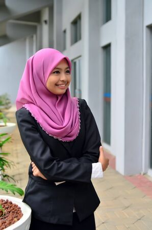 A young muslim girl with hijab  head scarf  smiling  photo
