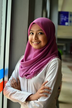 Close-up portrait of beautiful young Asian student study smile photo