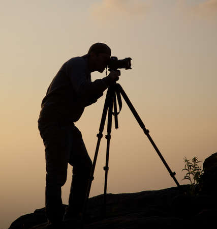 tripod: The Photographer Stock Photo