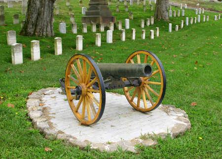 canon in front of veterans tombstones