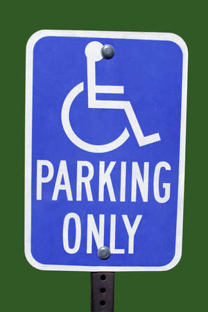 blue handicap parking sign with green background