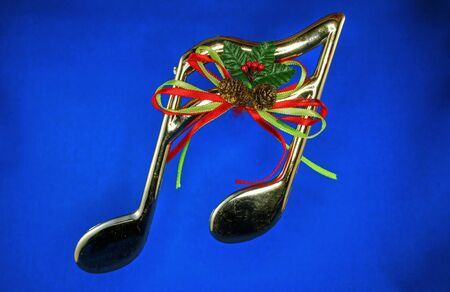christmas backgrounds: Shiny Christmas musical notes Stock Photo