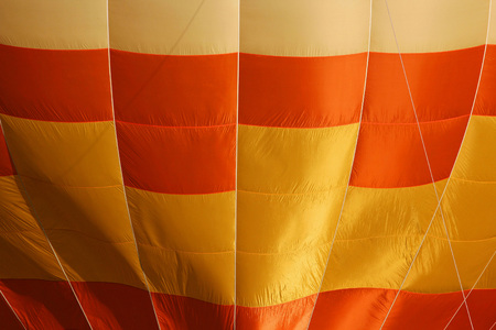 crimson colour: Yellow and orange balloon background lines and textureClose-up view of a colourful hot-air balloon to use as background