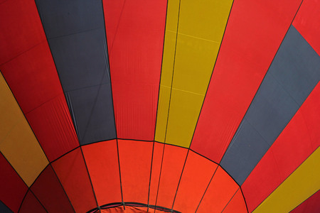 vertical red yellow black Close-up view of a colourful hot-air balloon to use as background