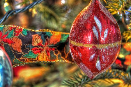 Red Christmas decoration with ribon on a tree Stock Photo