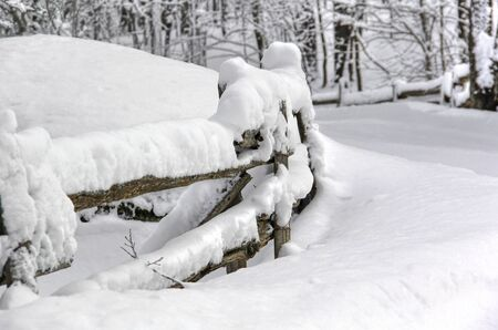 Eastern Townships winter fence after a snowfall Stock Photo