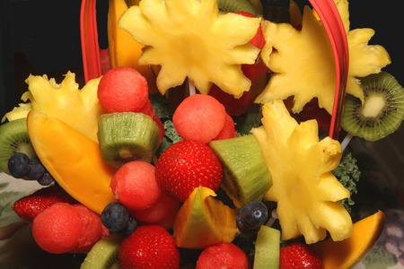Various fruits in a basket display presentation for gifting