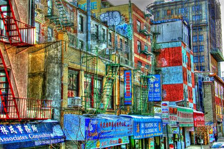 Grunge colorfull view of streets in New York with various signs