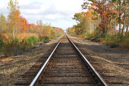 Train tracks in the fall with no one around