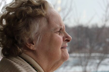 Elderly woman living her solitude and confinement