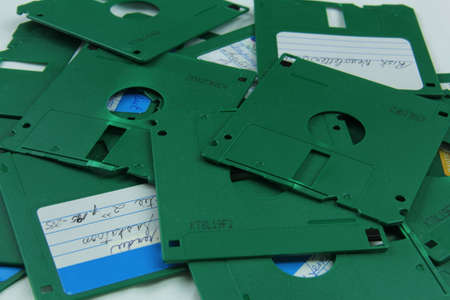 Old green floppy disks destroyed for recycling and security Standard-Bild