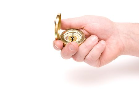 orienting: The hand holds compass on white background Stock Photo