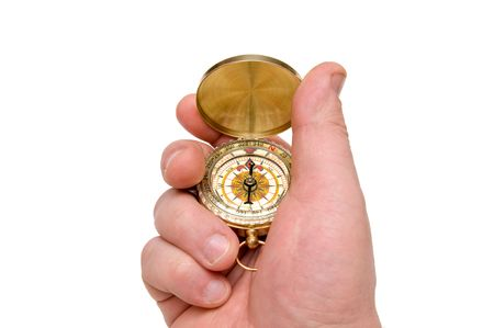 The hand holds compass on white background Foto de archivo