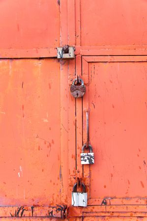 Background rusty gate are closed on the lock Stock Photo - 6660749