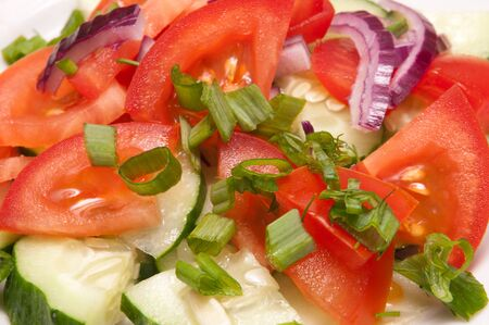 Salad from fresh a tomato of cucumbers and onions photo