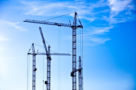 The crane elevating against the sky