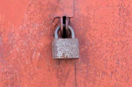 Old padlock on garage collars Stock Photo - 7389340