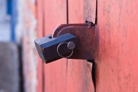 Old padlock on garage collars Stock Photo - 7389325