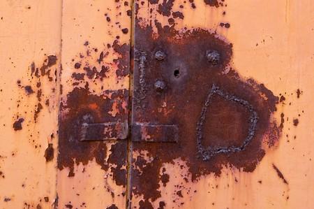 Old padlock on garage collars Stock Photo - 7389342