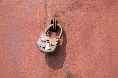 Old padlock on garage collars Stock Photo - 7389348