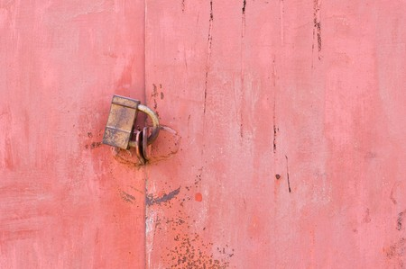 Old padlock on garage collars Stock Photo - 7389371