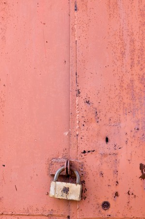 Old padlock on garage collars Stock Photo - 7389345