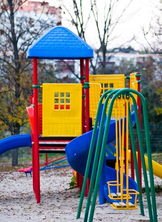Swing and hill on a children's playground Stock Photo - 7976425