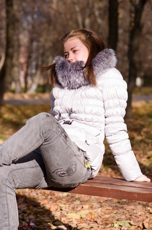 young girl on a park bench photo