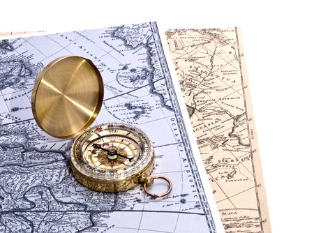 surveyor: compass lies on an ancient world map