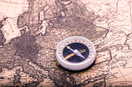 compass lies on an ancient world map