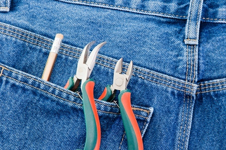 pliers to repair a pocket of jeans photo
