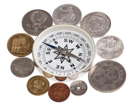Coins of the world are around the compass