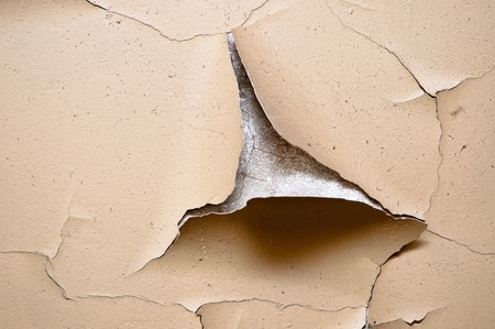 brown wall with cracked plaster time