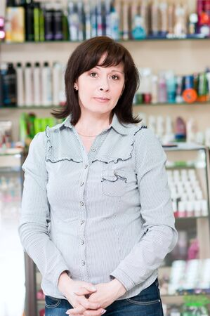 a woman standing in a beauty shop photo