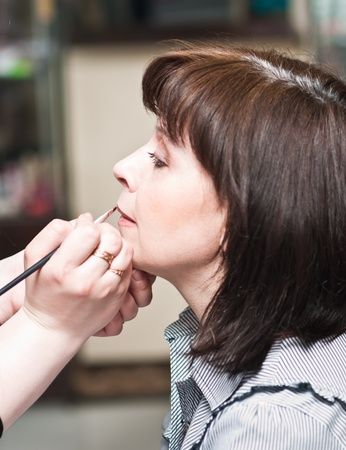 woman in a beauty salon doing make-up Stock Photo - 9345496