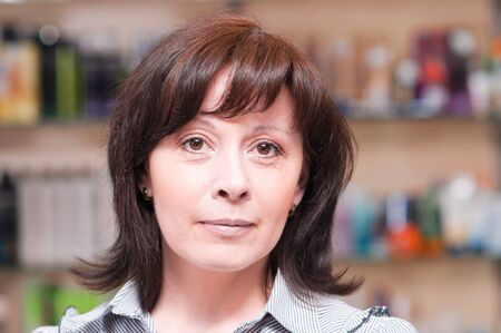 middle-aged woman looks thoughtfully photo