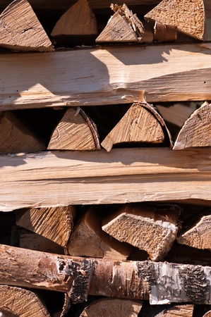the warmth: stacked firewood for warmth in winter