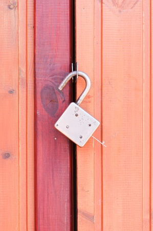 Old padlock on garage collars Stock Photo - 9741869